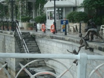 5 Little boys jumping into Singapore River